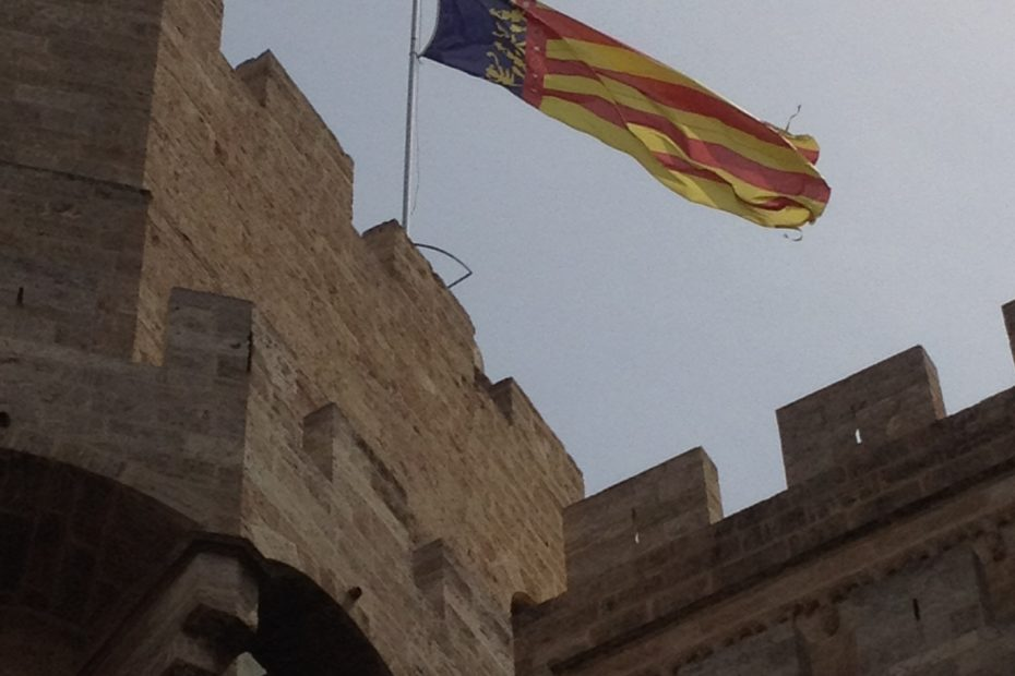 Valencian flag flying over one of the town gates